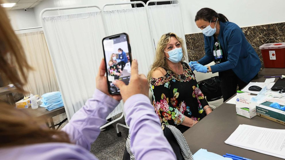 PHOTO: Mara Bianco takes a photo of Dawn Casale as she receives the Johnson & Johnson COVID-19 vaccine at the Northwell Health pop-up vaccination site at the Albanian Islamic Cultural Center in Staten Island on April 08, 2021, in New York City.
