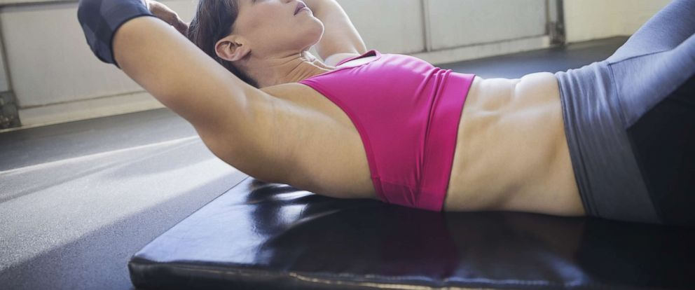 PHOTO: A woman does sit-ups in an undated stock photo.