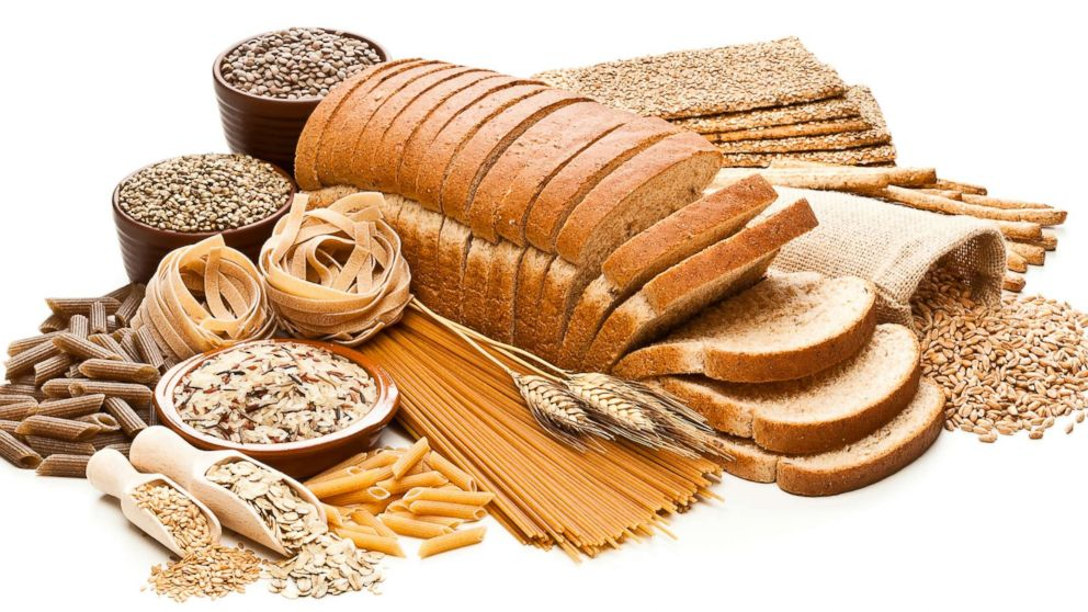 Various grains, lentils and whole grain breads and pasta products are displayed in an undated stock photo.