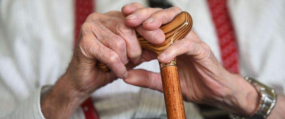 PHOTO: An elderly man holds on to a cane in a file photo, May 18, 2017.