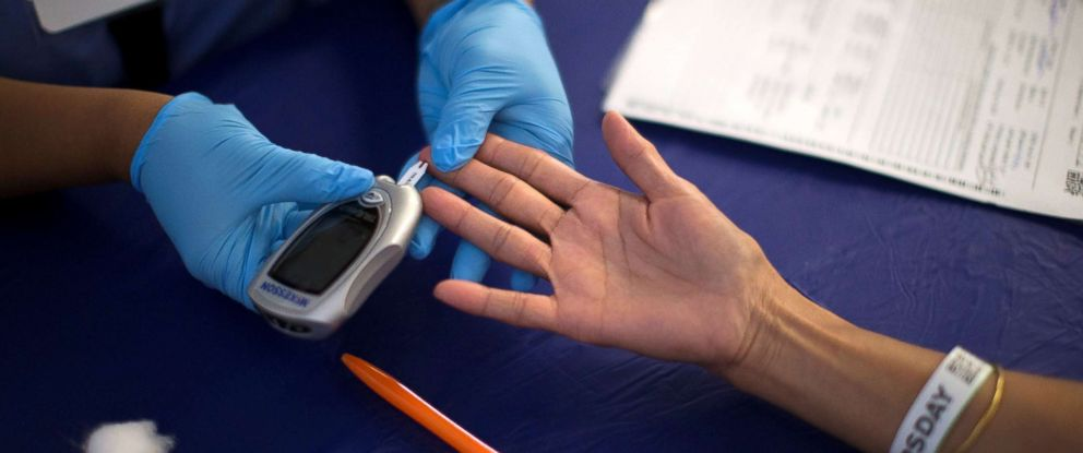 PHOTO: A person receives a test for diabetes during Care Harbor LA free medical clinic in Los Angeles, Sept. 11, 2014.