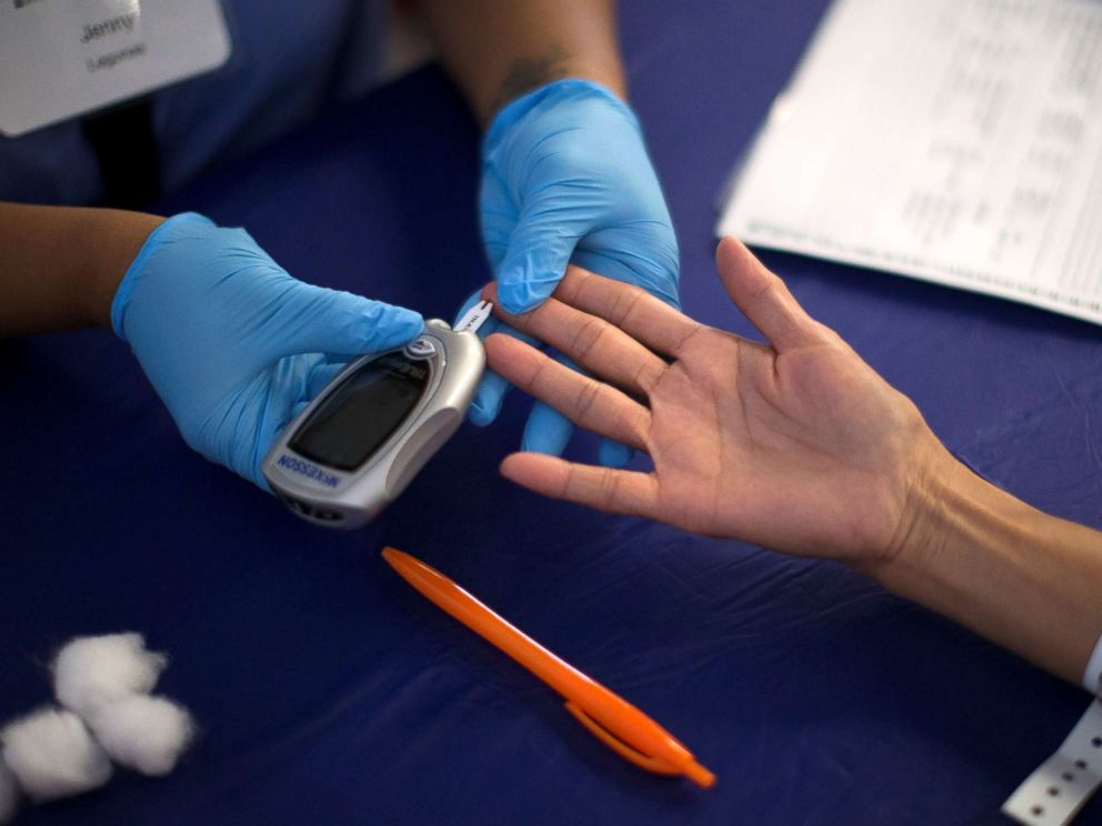 PHOTO: A person receives a diabetes test during the free Care Harbor LA medical clinic in Los Angeles on September 11, 2014.
