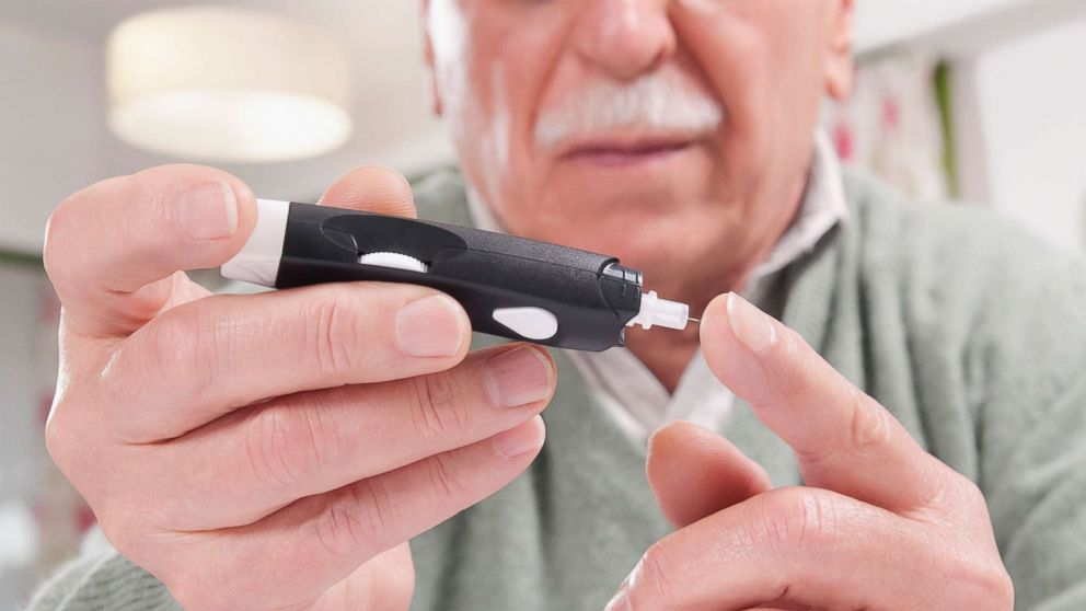 Testing blood sugar level in an undated stock photo.