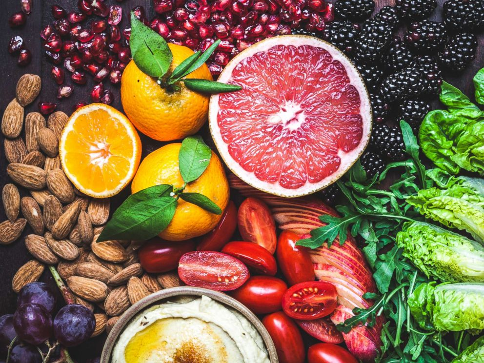 PHOTO: A rainbow of colors and textures in this vibrant and healthy snack board of fruit, vegetables, dips, nuts and olives.