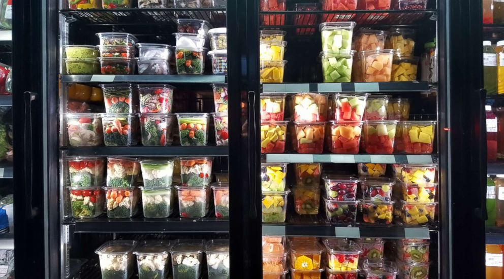 PHOTO: Healthy cut fruit and vegetables on display in store window of a grocery store in the East Village, New York, N.Y.