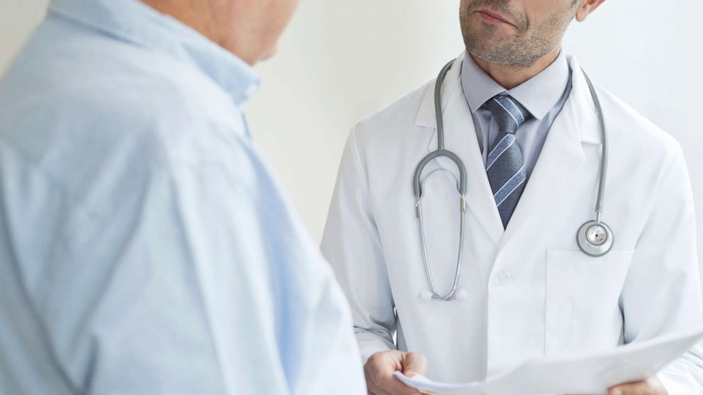 A doctor speaks to a patient in an undated stock photo.