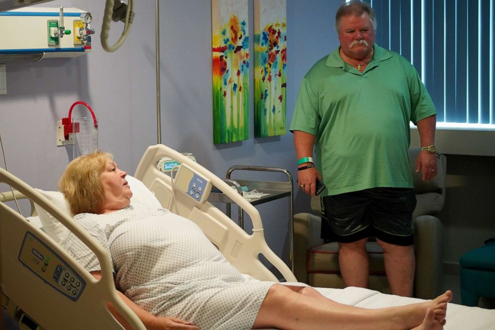 PHOTO: If Donna Ferguson went to a hospital near her home in Ecru, Miss., for a knee replacement, she would have paid several thousand dollars in copayments under the health plan offered through her husband Terry's employer, Ashley Furniture Industries.