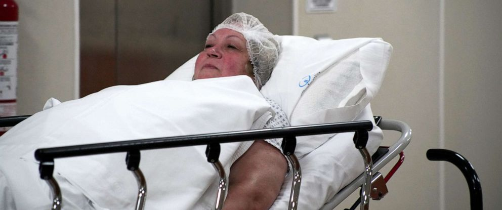 PHOTO: Donna Ferguson is wheeled into surgery at Galenia Hospital in Cancun, Mexico.