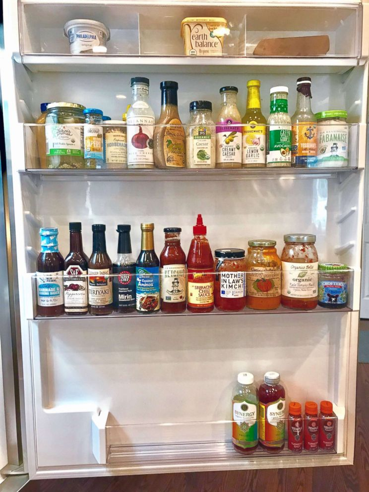 PHOTO: The Food Fix founder Heather Bauer organizes condiments on the door of her refrigerator.