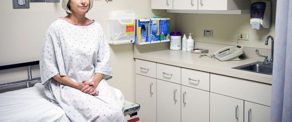 PHOTO: A woman sits in a doctors office in this updated stock photo.