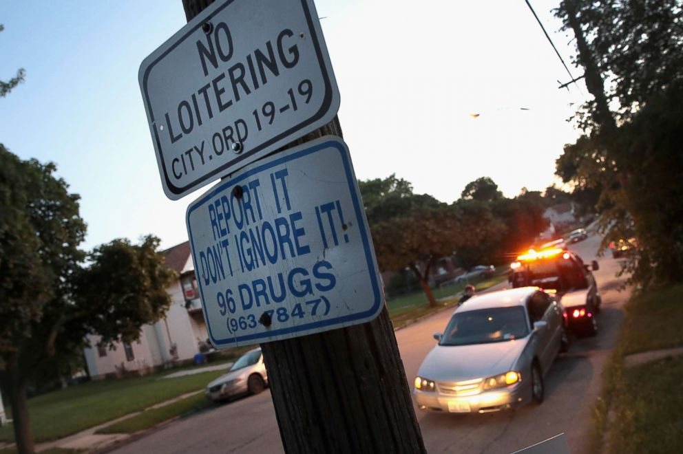 PHOTO: A sign encourages residents to report drug problems in Rockford, Illinois, July 13, 2017. This city of about 150,000 located in northern Illinois, averages about 2 overdose deaths per week, most which are heroin related.