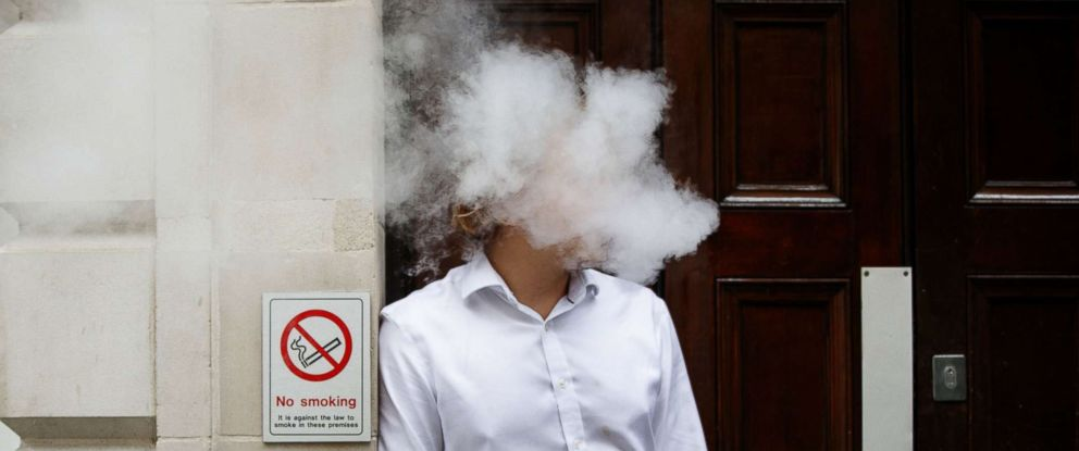PHOTO: A smoker is engulfed by vapors as he smokes an electronic vaping machine during lunch time in central London, Aug. 9, 2017.