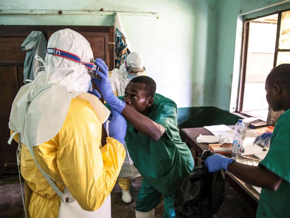 PHOTO: A handout photograph released by UNICEF on May 13, 2018 shows health workers wearing protective equipment as they prepare to attend to suspected Ebola patients at Bikoro Hospital in the Democratic Republic of Congo, May 12, 2018.