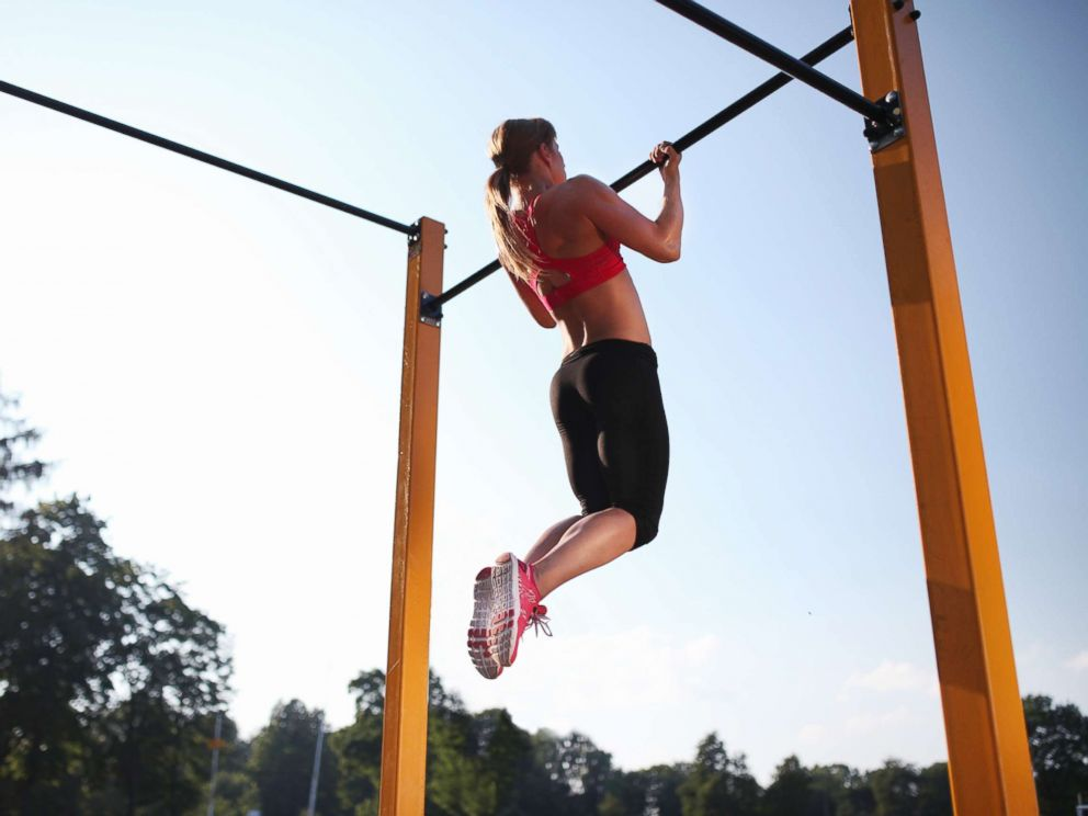 PHOTO: A woman trains on a chin up bar outdoors in this undated stock photo.