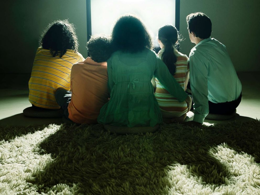 PHOTO: A family watch television together in this undated stock photo.