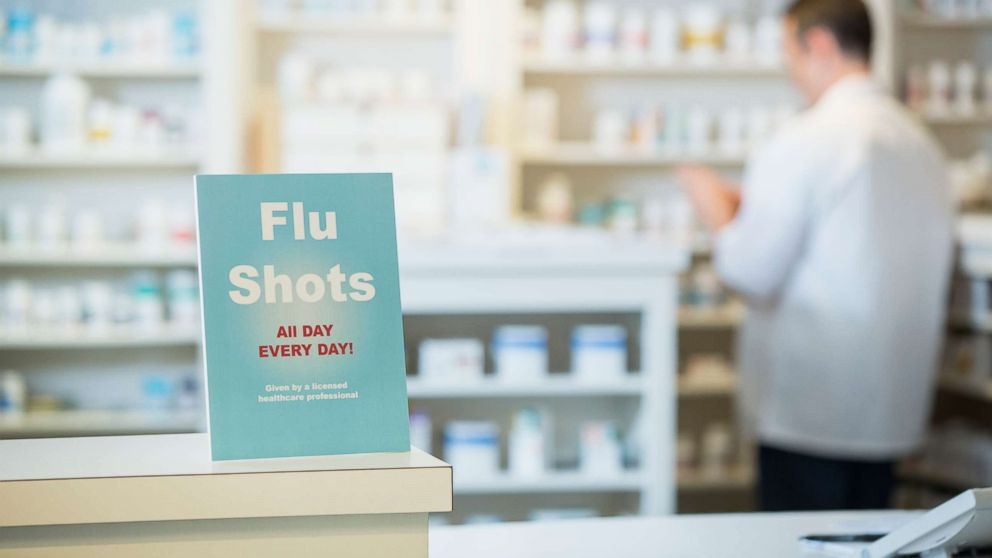 A flu shots sign is seen in a pharmacy in this undated stock photo.