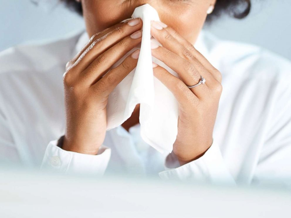 PHOTO: A woman blows her nose in this undated stock photo.