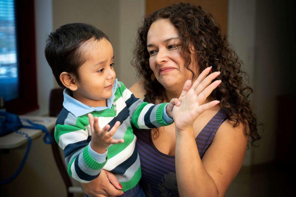 PHOTO: Gael Jesus Pino Alva, 2, is held by his mother, Giannina Alva, at a hospital in Memphis.
