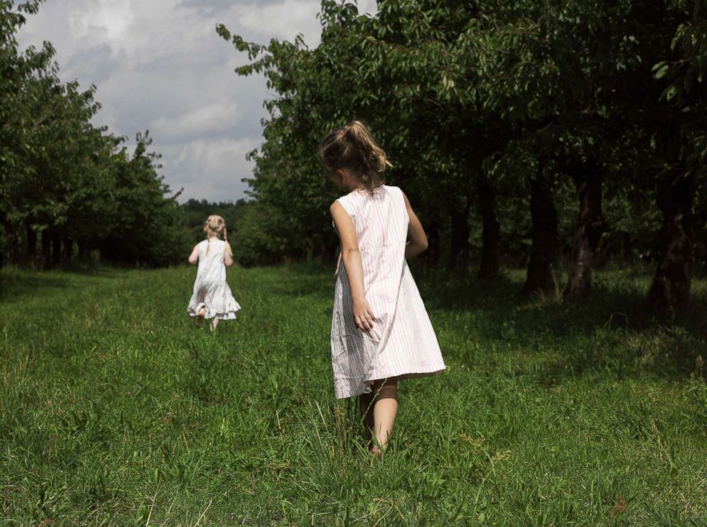 PHOTO: Two girls walk through a field in this undated stock photo.