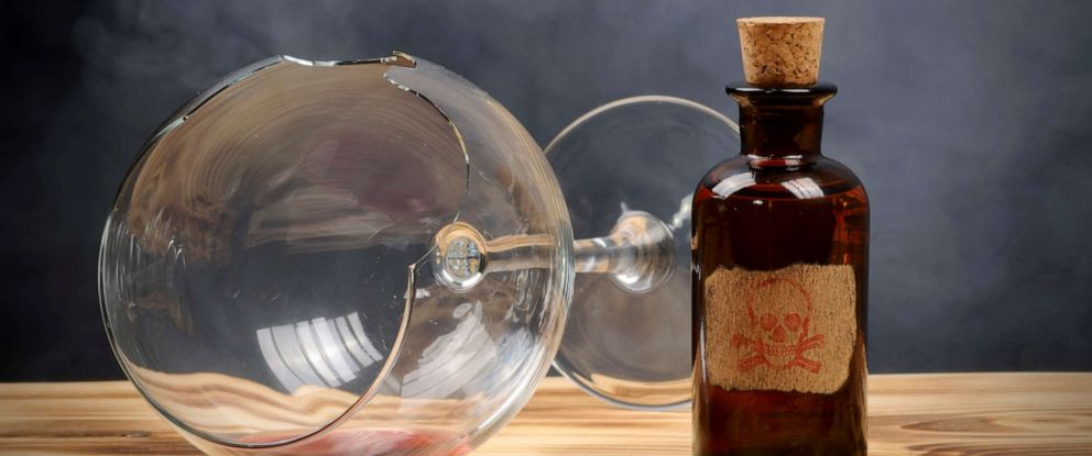 PHOTO: A broken wine glass and poison bottle are seen in this stock photo.