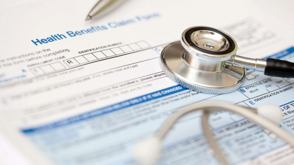 This stock photo depicts a hospital bill and stethoscope.