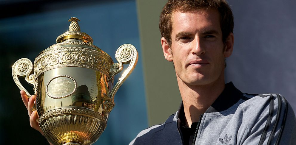 PHOTO: British tennis player Andy Murray poses with the 2013 Wimbledon trophy at the All England Club in Wimbledon, southwest London, on July 8, 2013.