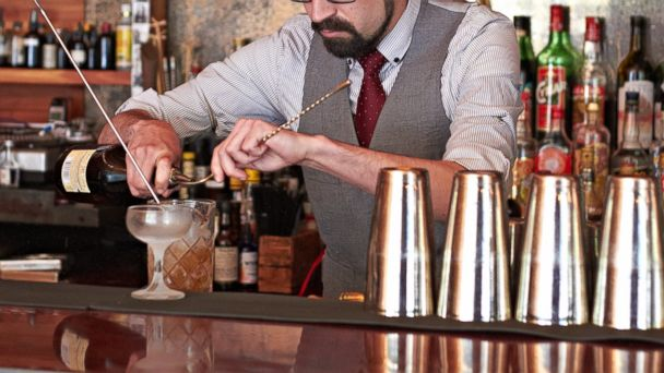 PHOTO: A bartender making a drink in a bar.