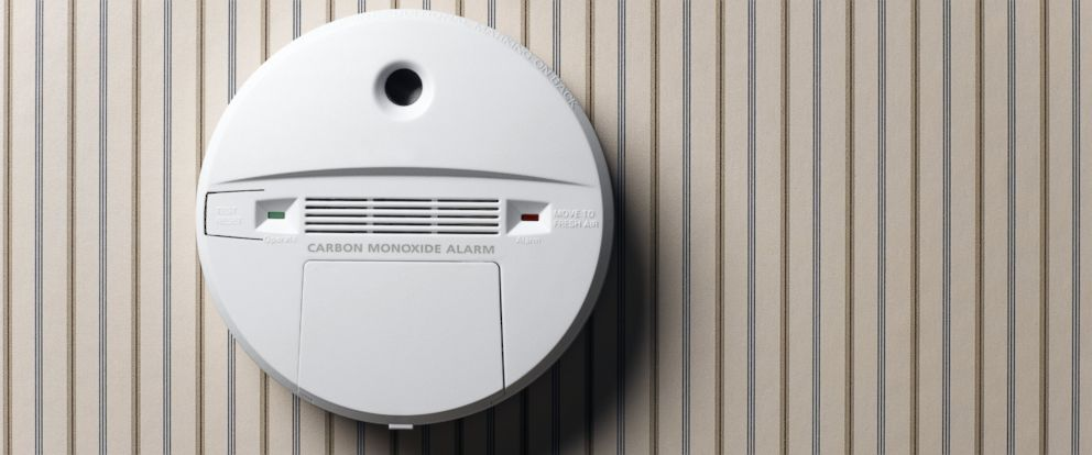 PHOTO: A smoke detector and carbon monoxide alarm mounted on wall.