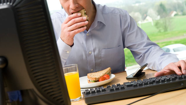 PHOTO: When you nosh as you work, especially if youre sitting in front of your computer, youre more likely to overeat, according to research in The American Journal of Clinical Nutrition.