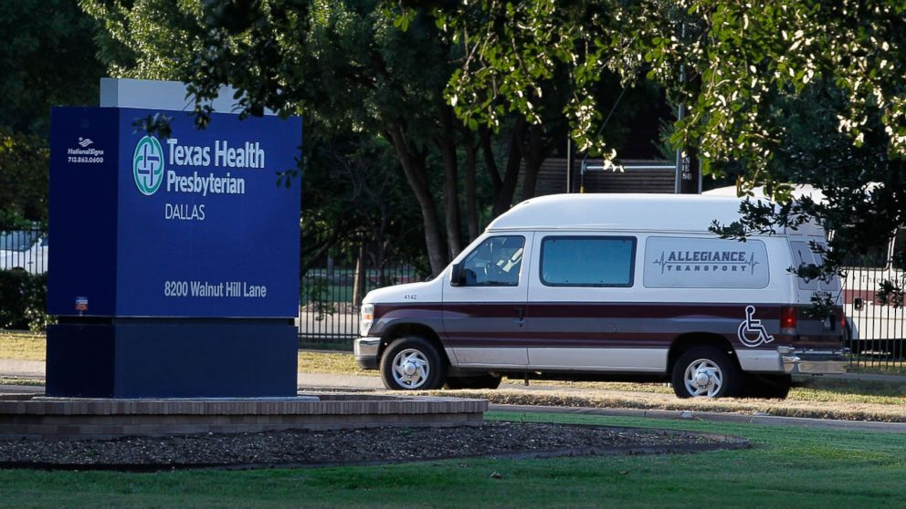 A medical transport van moves past Texas Health Presbyterian Hospital Dallas where a patient has been diagnosed with the Ebola virus, Sept. 30, 2014 in Dallas, Texas.