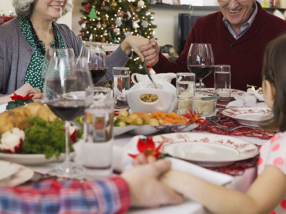 PHOTO: This stock photo depicts a family sitting down to a Christmas dinner.