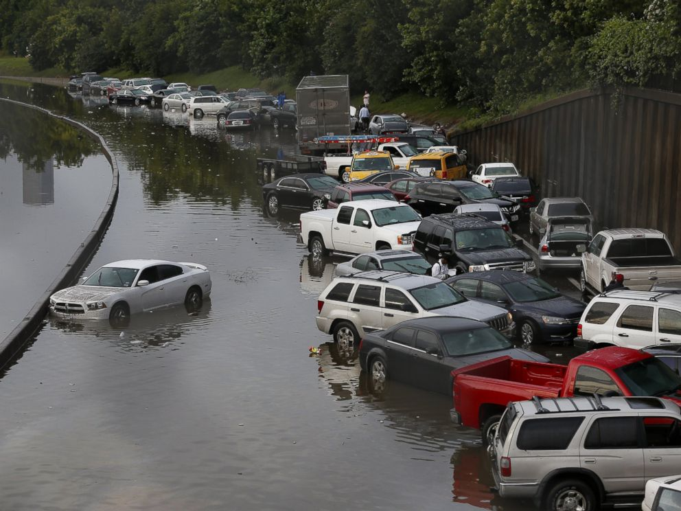 PHOTO: Vehicles sit stranded on a flooded Interstate 45 in Houston, Texas on May 26, 2015.