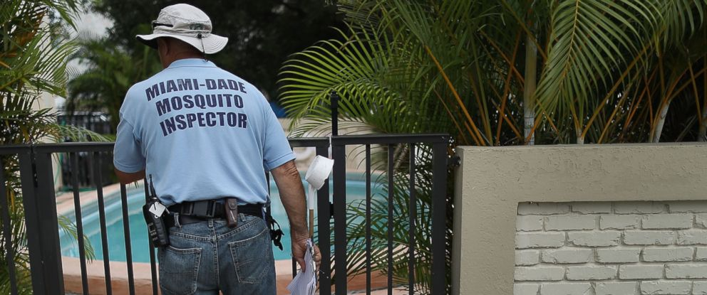 PHOTO: A Miami-Dade County mosquito control inspector looks for places that might hold breeding mosquitos that are carrying the Zika virus on Sept. 2, 2016 in Miami Beach, Florida.