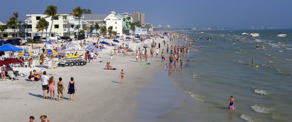 PHOTO: People walk along Fort Myers Beach, Fla.