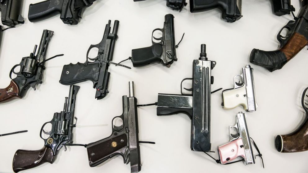 An assortment of hand guns sit on display at a news conference to announce results of the city's Gun Buyback Program, on May 11, 2015 in Los Angeles.