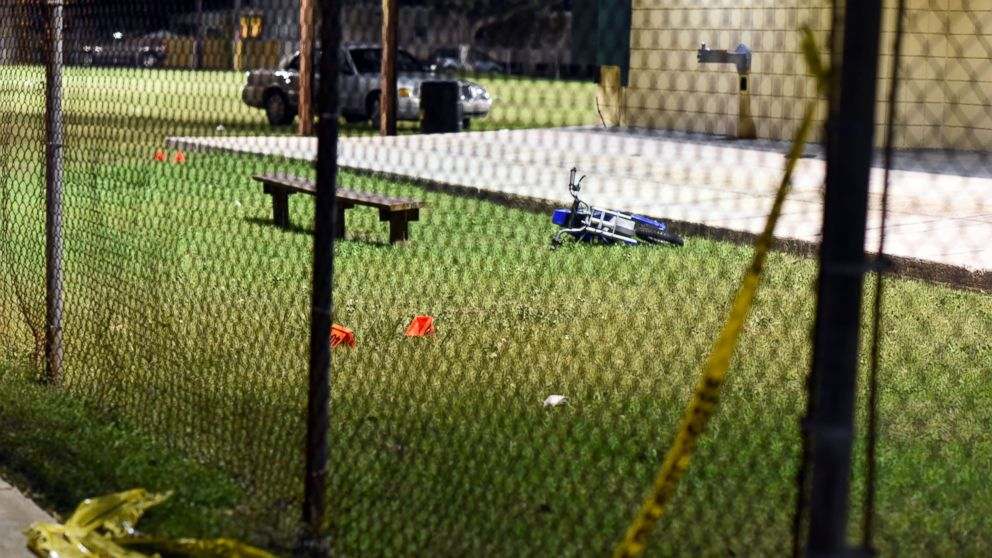 Evidence markers sit on the ground after a shooting at a playground on Nov. 22, 2015 in New Orleans.