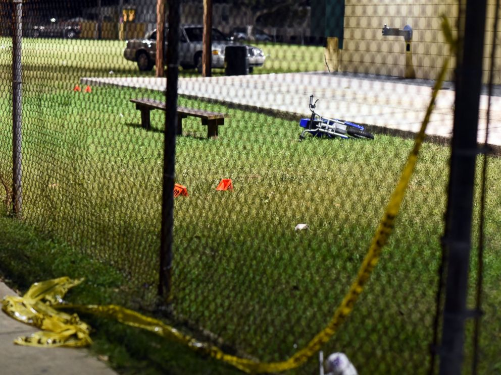 PHOTO: Evidence markers sit on the ground after a shooting at a playground on Nov. 22, 2015 in New Orleans.