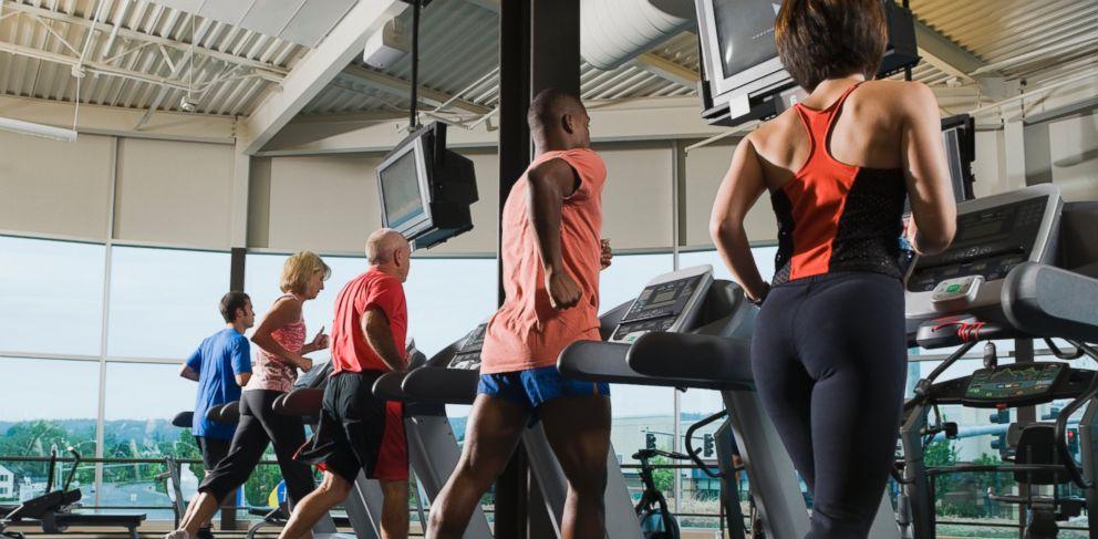 PHOTO: Men and women running on treadmills.