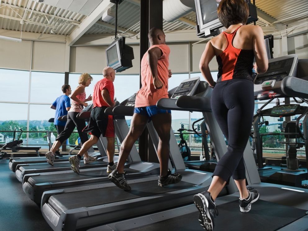 PHOTO: Men and women are running on treadmills in this undated stock photo.