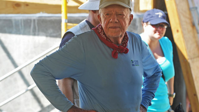 PHOTO: Former US president Jimmy Carter helps build a house as he visits the construction site of houses being built by Carter's Habitat for Humanity foundation for victims of the January 2010 earthquake in Leogane, 33km south of Port-au-Prince, on Novemb
