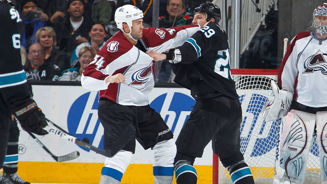PHOTO: Ryane Clowe #29 of the San Jose Sharks fights Daniel Winnik #34 of the Colorado Avalanche at HP Pavilion, San Jose, California, Dec. 15, 2011.