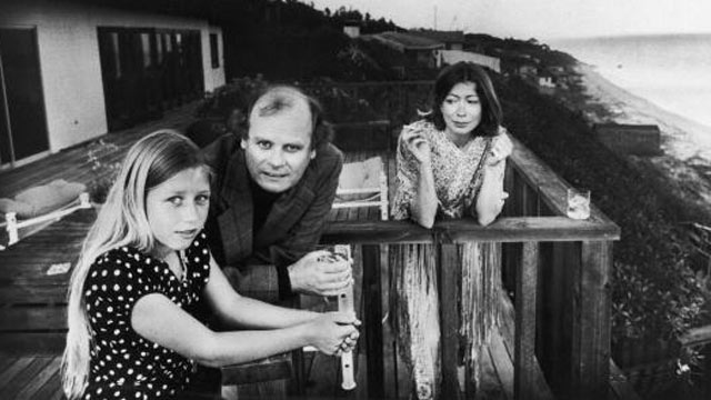 PHOTO: On a patio deck overlooking the ocean, Quintana Roo Dunne, left, leans on a railing with her parents, American authors and scriptwriters John Gregory Dunne and Joan Didion, in Malibu, Calif., in 1976.