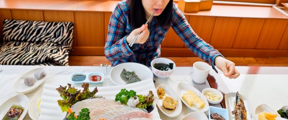 PHOTO: Watching strangers eat on television is a trend that has recently gone mainstream in South Korea. Pictured: A woman eats Korean food in an undated stock photo.