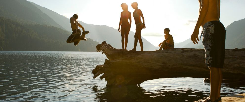 Swimmers enjoy themselves in an undated stock photo.