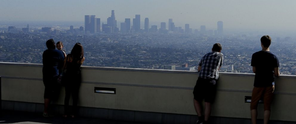 PHOTO: Visitors to Griffith park overlook a smoggy L.A. Basin in Los Angeles, Calif., Oct. 24, 2014.