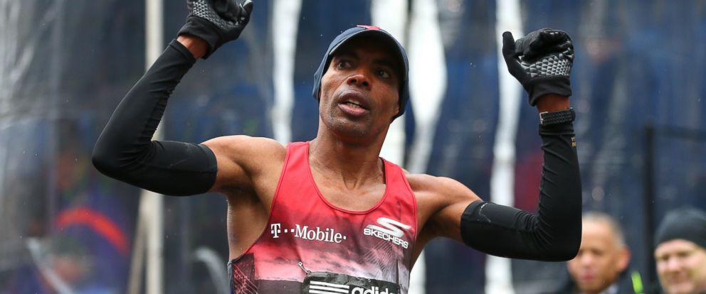 PHOTO: Meb Keflezighi of the United States reacts after crossing the finish line during the 119th Boston Marathon on April 20, 2015 in Boston, Mass.