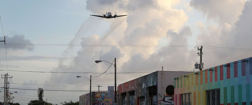 PHOTO: A plane sprays pesticide over Miamis Wynwood neighborhood on Aug. 6, 2016 in Miami.