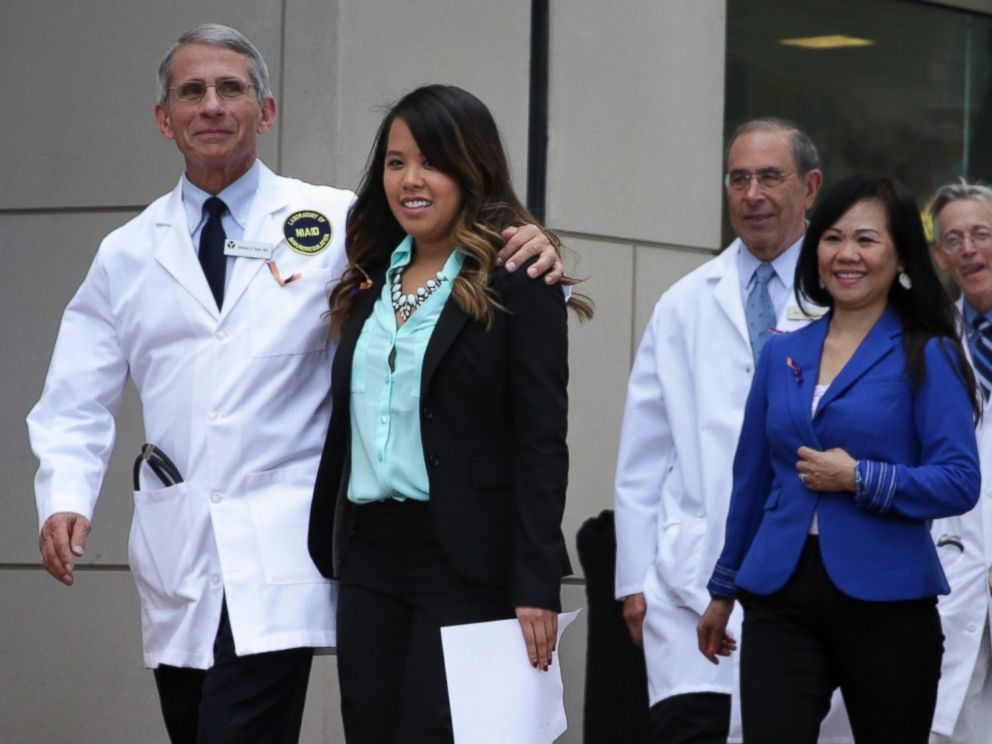 PHOTO: Director of the National Institute of Allergy and Infectious Diseases Anthony Fauci comes out of the building with Nina Pham for a news briefing at National Institutes of Health on Oct. 24, 2014 in Bethesda, Md.