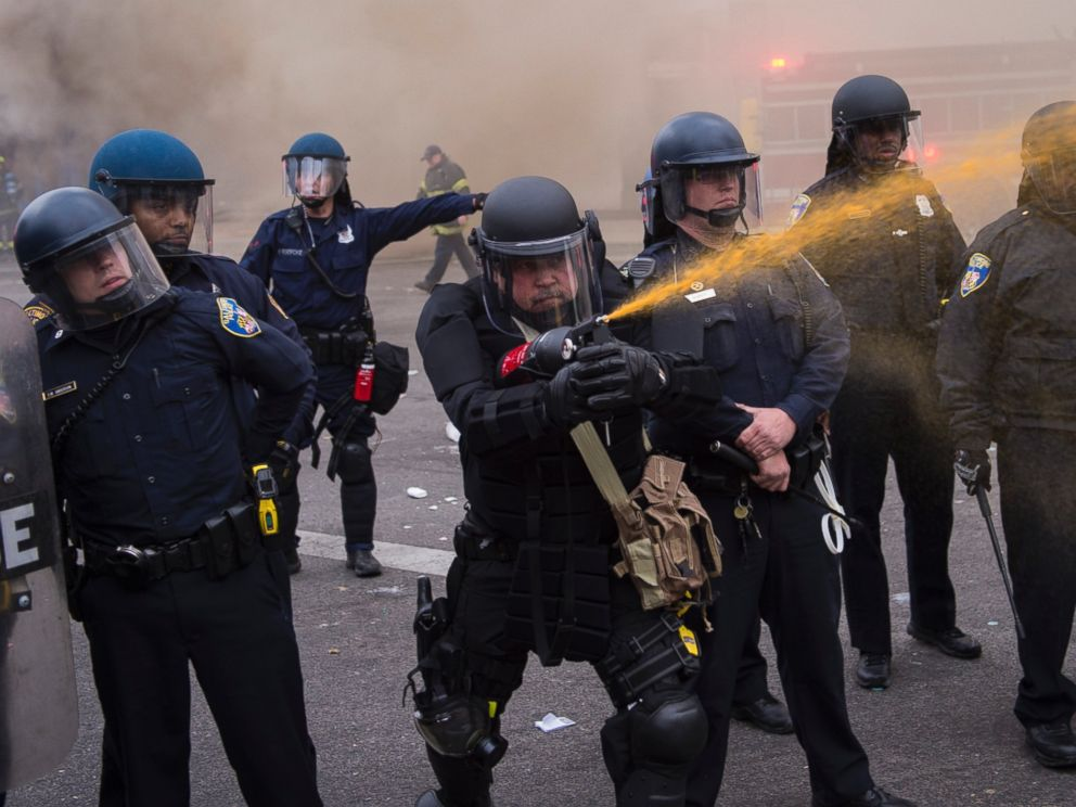 PHOTO: Officers pepper spray people near West North Avenue and Pennsylvania Avenue during a protest for Freddie Gray in Baltimore, Md. on April 27, 2015.