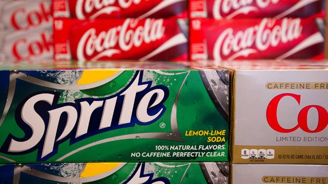 PHOTO: Coca-Cola Co. beverages displayed on shelf in a grocery store in Atlanta, Georgia, U.S., on Feb.7, 2012.